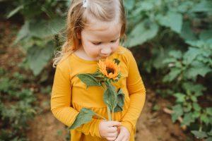 Little Girl with Sunflower